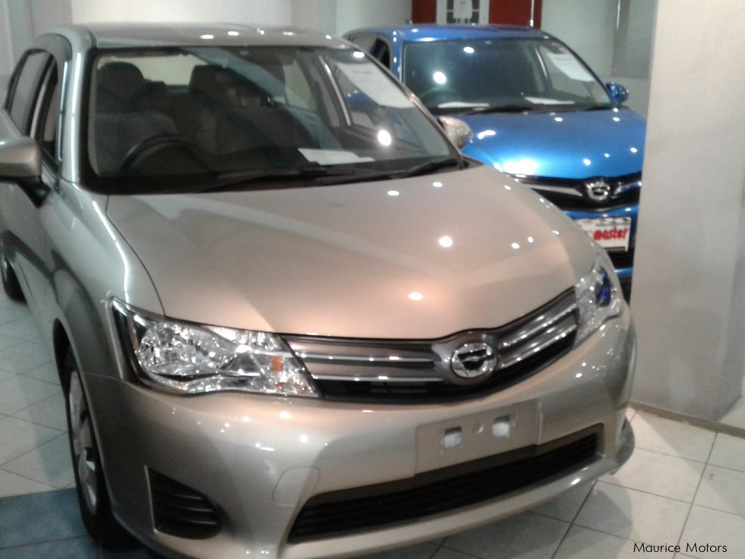 Used Toyota AXIO - VERY LOW MILEAGE - LIGHT BROWN in Mauritius