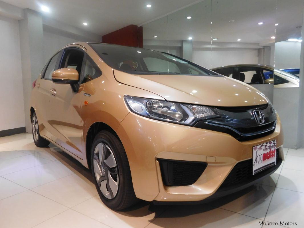 Used Honda FIT - GOLD MET - HYBRID for sale in Rose Hill