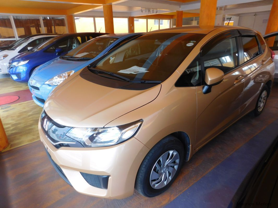 Pre-owned Honda FIT - 13G - F-PACKAGE - BEIGE for sale in Eau Coulée, Curepipe
